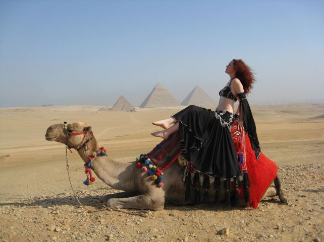 Jade sun baking on a camel - Belly Dancer on a camel in Egypt