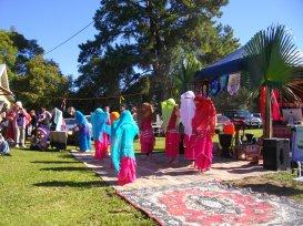 veiled children dancing