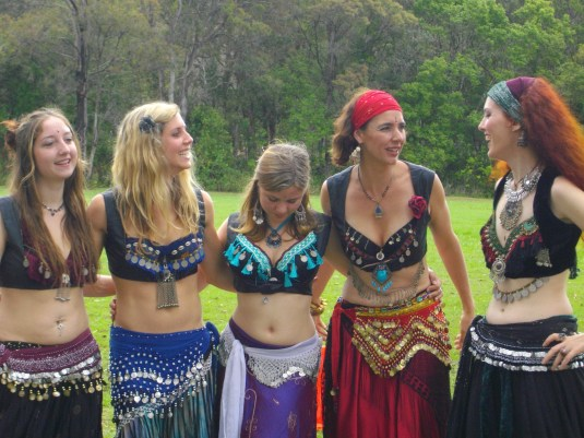 tribal students share a laugh after a belly dance performance