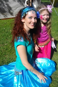 Belly dancing mother and child