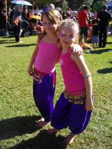 face painted belly dancing kids