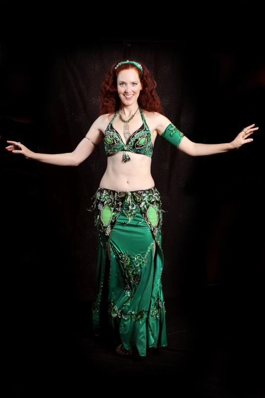 Tall red head belly dancing