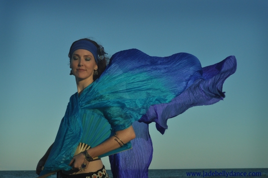 Bellydancing with Silk fan veils beach