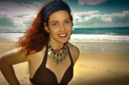 Glamorous preset and hair smoothers used form portrait pro. I think it is over done for a beach scene but I did it so you could see the differences.